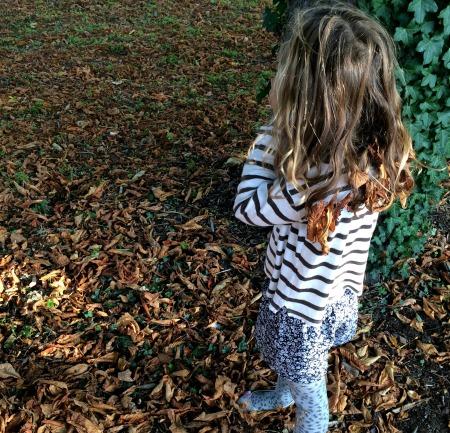 Mia leaves in her hair